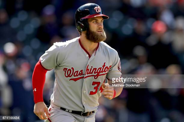 Bryce Harper of the Washington Nationals circles the bases after hitting a 3 RBI home run in the seventh inning against the Colorado Rockies at Coors...