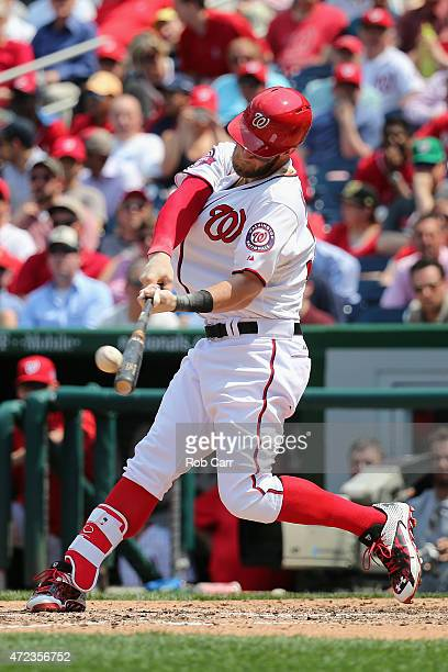 Bryce Harper of the Washington Nationals connects for a solo home run in the fifth inning against the Miami Marlins at Nationals Park on May 6 2015...