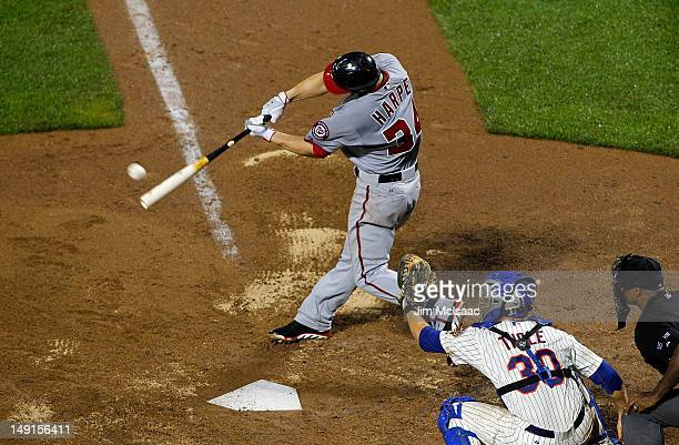Bryce Harper of the Washington Nationals connects on a tenth inning RBI single against the New York Mets at Citi Field on July 23 2012 in the...
