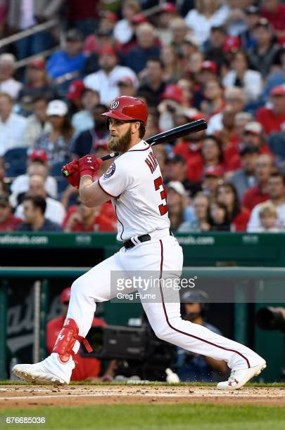 Bryce Harper of the Washington Nationals drives in a run with a single in the first inning against the Arizona Diamondbacks at Nationals Park on May...