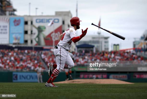 Bryce Harper of the Washington Nationals flips hit bat after hitting a home run in the sixth inning of the Opening Day game against the Miami Marlins...