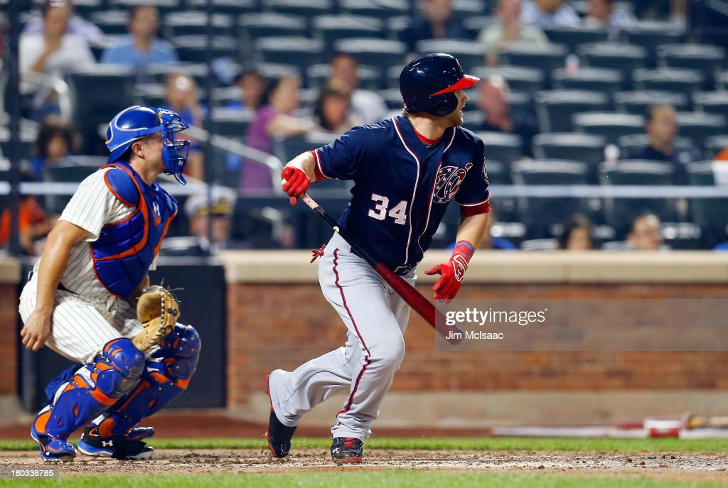 <a gi-track='captionPersonalityLinkClicked' href=/galleries/search?phrase=Bryce+Harper&family=editorial&specificpeople=5926486 ng-click='$event.stopPropagation()'>Bryce Harper</a> #34 of the Washington Nationals follows through on a fourth inning infield single against the New York Mets at Citi Field on September 11, 2013 in the Flushing neighborhood of the Queens borough of New York City.