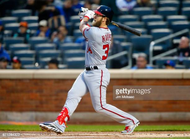 Bryce Harper of the Washington Nationals follows through on his first inning two run home run against the New York Mets at Citi Field on April 21...