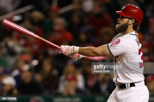 Bryce Harper of the Washington Nationals follows through on his walk off home run during the ninth inning against the Philadelphia Phillies at...