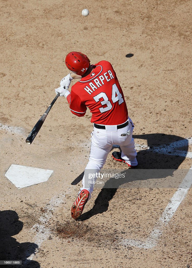 <a gi-track='captionPersonalityLinkClicked' href=/galleries/search?phrase=Bryce+Harper&family=editorial&specificpeople=5926486 ng-click='$event.stopPropagation()'>Bryce Harper</a> #34 of the Washington Nationals fouls off a pitch during the seventh inning against the Atlanta Braves at Nationals Park on April 13, 2013 in Washington, DC.