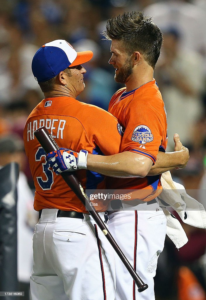 Bryce Harper of the Washington Nationals gets a hug from his father Ron Haper during the Chevrolet Home Run Derby on July 15, 2013 at Citi Field in the Flushing neighborhood of the Queens borough of New York City.