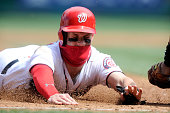 Bryce Harper of the Washington Nationals gets tagged out at third base in the first inning against the Miami Marlins at Nationals Park on April 10...