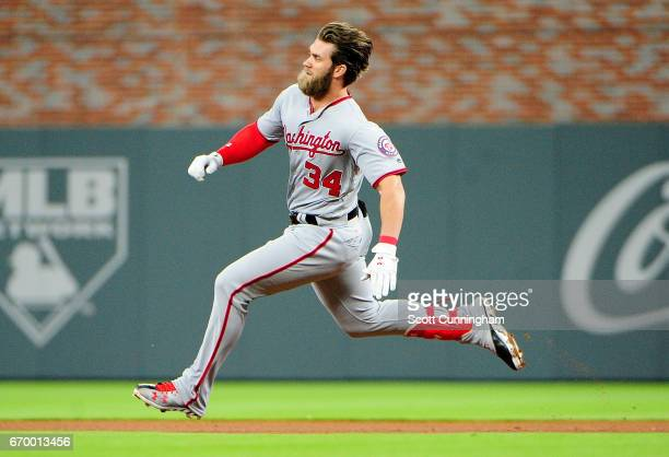 Bryce Harper of the Washington Nationals heads to second for a fourth inning double against the Atlanta Braves at SunTrust Park on April 18 2017 in...