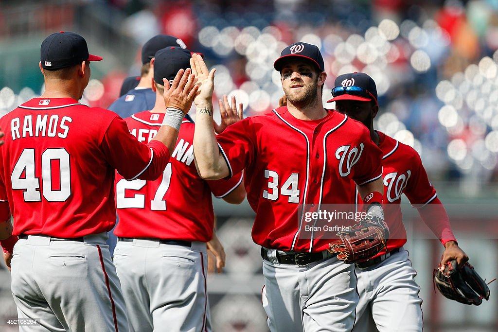 <a gi-track='captionPersonalityLinkClicked' href=/galleries/search?phrase=Bryce+Harper&family=editorial&specificpeople=5926486 ng-click='$event.stopPropagation()'>Bryce Harper</a> #34 of the Washington Nationals high fives teammates after the game against the Philadelphia Phillies at Citizens Bank Park on July 13, 2014 in Philadelphia, Pennsylvania. The Nationals won 10-3.