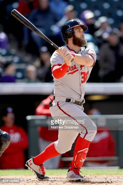 Bryce Harper of the Washington Nationals hits a 3 RBI home run in the seventh inning against the Colorado Rockies at Coors Field on April 27 2017 in...