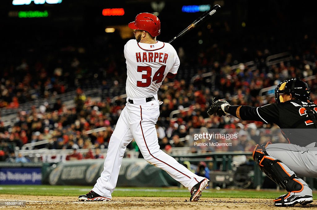 <a gi-track='captionPersonalityLinkClicked' href=/galleries/search?phrase=Bryce+Harper&family=editorial&specificpeople=5926486 ng-click='$event.stopPropagation()'>Bryce Harper</a> #34 of the Washington Nationals hits a double to right field in the eighth inning during a game against the Miami Marlins at Nationals Park on April 3, 2013 in Washington, DC. The Nationals defeated the Marlins 3-0.