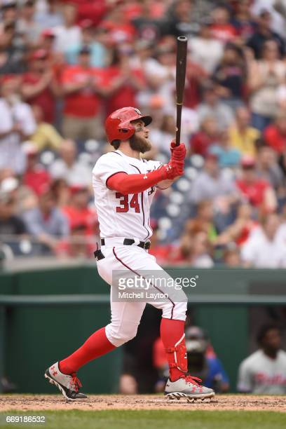 Bryce Harper of the Washington Nationals hits a game winning three run home run in the ninth inning during a baseball game against the Philadelphia...