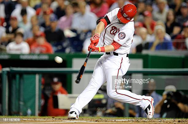 Bryce Harper of the Washington Nationals hits a home run in the first inning against the Miami Marlins at Nationals Park on September 19 2013 in...