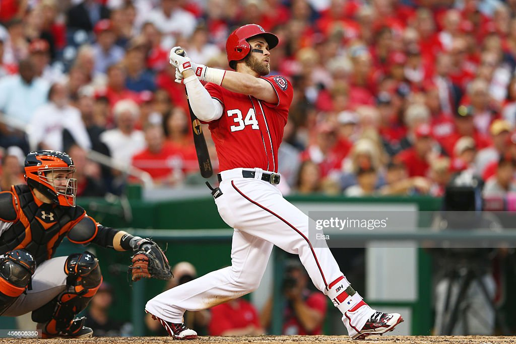 <a gi-track='captionPersonalityLinkClicked' href=/galleries/search?phrase=Bryce+Harper&family=editorial&specificpeople=5926486 ng-click='$event.stopPropagation()'>Bryce Harper</a> #34 of the Washington Nationals hits a home run in the seventh inning against the San Francisco Giants during Game One of the National League Division Series at Nationals Park on October 3, 2014 in Washington, DC.