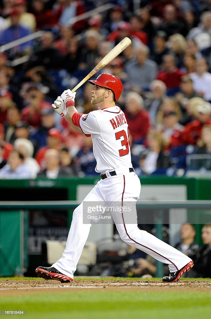 <a gi-track='captionPersonalityLinkClicked' href=/galleries/search?phrase=Bryce+Harper&family=editorial&specificpeople=5926486 ng-click='$event.stopPropagation()'>Bryce Harper</a> #34 of the Washington Nationals hits a home run in the third inning against the Cincinnati Reds at Nationals Park on April 25, 2013 in Washington, DC.