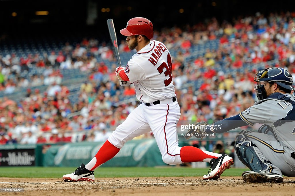 <a gi-track='captionPersonalityLinkClicked' href=/galleries/search?phrase=Bryce+Harper&family=editorial&specificpeople=5926486 ng-click='$event.stopPropagation()'>Bryce Harper</a> #34 of the Washington Nationals hits a line ball out to center in the fourth inning during a game against the Milwaukee Brewers at Nationals Park on July 3, 2013 in Washington, DC.