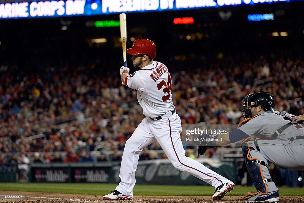 <a gi-track='captionPersonalityLinkClicked' href=/galleries/search?phrase=Bryce+Harper&family=editorial&specificpeople=5926486 ng-click='$event.stopPropagation()'>Bryce Harper</a> #34 of the Washington Nationals hits a RBI sacrifice fly ball scoring Denard Span #2 in the third inning during a game against the Detroit Tigers at Nationals Park on May 8, 2013 in Washington, DC.