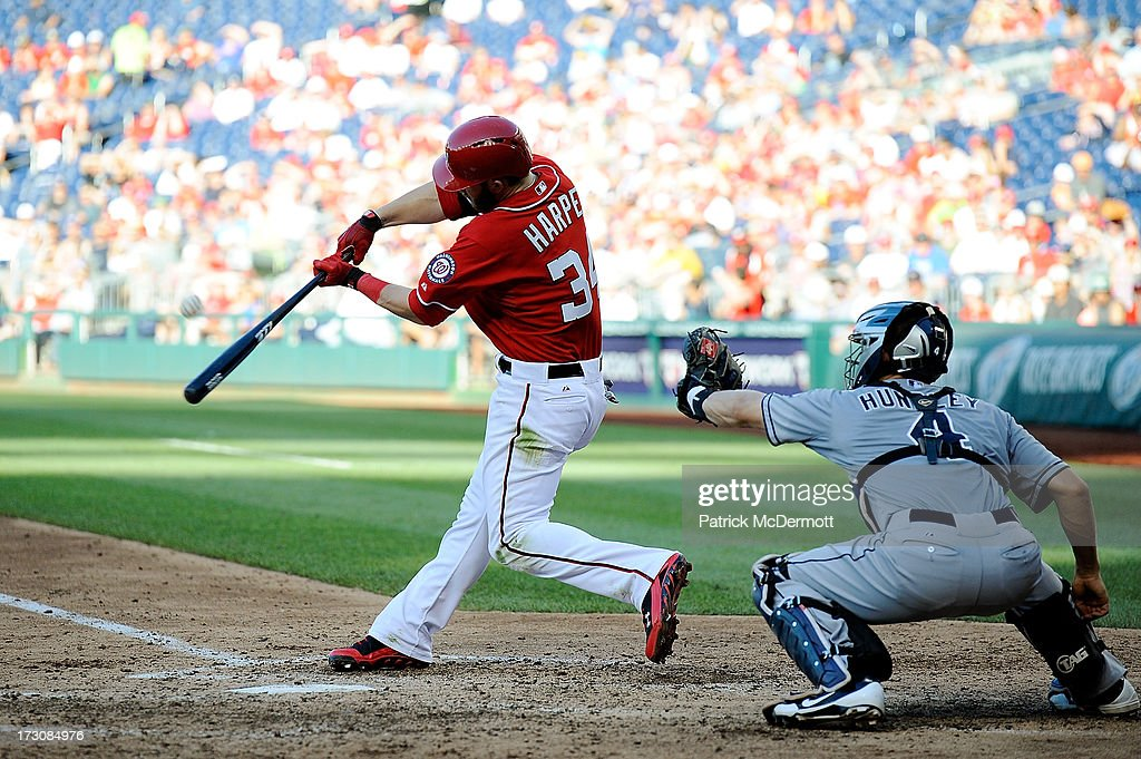<a gi-track='captionPersonalityLinkClicked' href=/galleries/search?phrase=Bryce+Harper&family=editorial&specificpeople=5926486 ng-click='$event.stopPropagation()'>Bryce Harper</a> #34 of the Washington Nationals hits a sacrifice fly to left scoring Denard Span #2 in the seventh inning during a game against the San Diego Padres at Nationals Park on July 6, 2013 in Washington, DC.