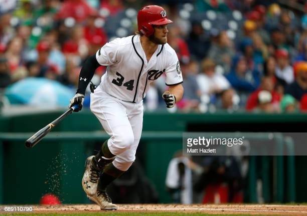 Bryce Harper of the Washington Nationals hits a single against the San Diego Padres during the first inning at Nationals Park on May 27 2017 in...