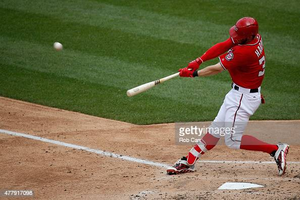 Bryce Harper of the Washington Nationals hits a solo home run against the Pittsburgh Pirates in the fourth inning at Nationals Park on June 20 2015...