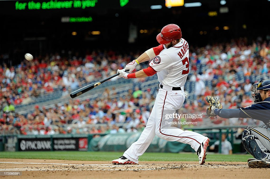 <a gi-track='captionPersonalityLinkClicked' href=/galleries/search?phrase=Bryce+Harper&family=editorial&specificpeople=5926486 ng-click='$event.stopPropagation()'>Bryce Harper</a> #34 of the Washington Nationals hits a solo home run in the first inning during a game against the Milwaukee Brewers at Nationals Park on July 1, 2013 in Washington, DC.