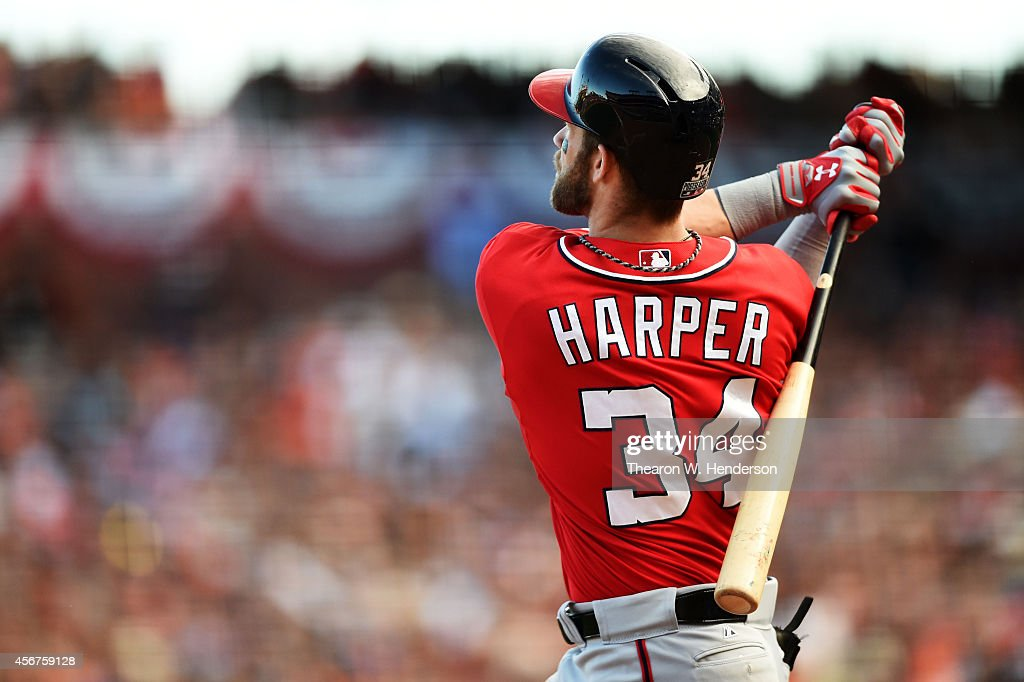 <a gi-track='captionPersonalityLinkClicked' href=/galleries/search?phrase=Bryce+Harper&family=editorial&specificpeople=5926486 ng-click='$event.stopPropagation()'>Bryce Harper</a> #34 of the Washington Nationals hits a solo home run in the ninth inning against the San Francisco Giants during Game Three of the National League Division Series at AT&T Park on October 6, 2014 in San Francisco, California.