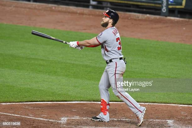 Bryce Harper of the Washington Nationals hits a solo home run in the eighth inning during a baseball game against the Baltimore Orioles at Oriole...