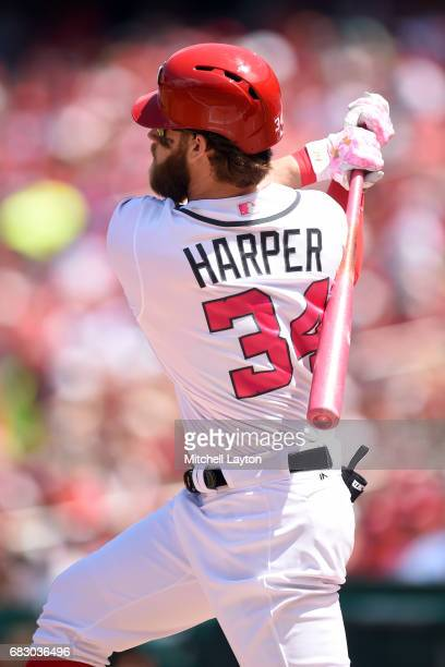 Bryce Harper of the Washington Nationals hits a solo home run in the first inning during a baseball game against the Philadelphia Phillies at...