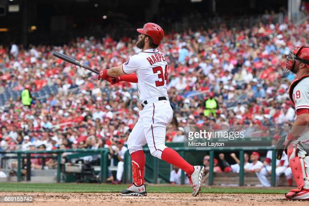 Bryce Harper of the Washington Nationals hits a two run home run in the third inning during a baseball game against the Philadelphia Phillies at...
