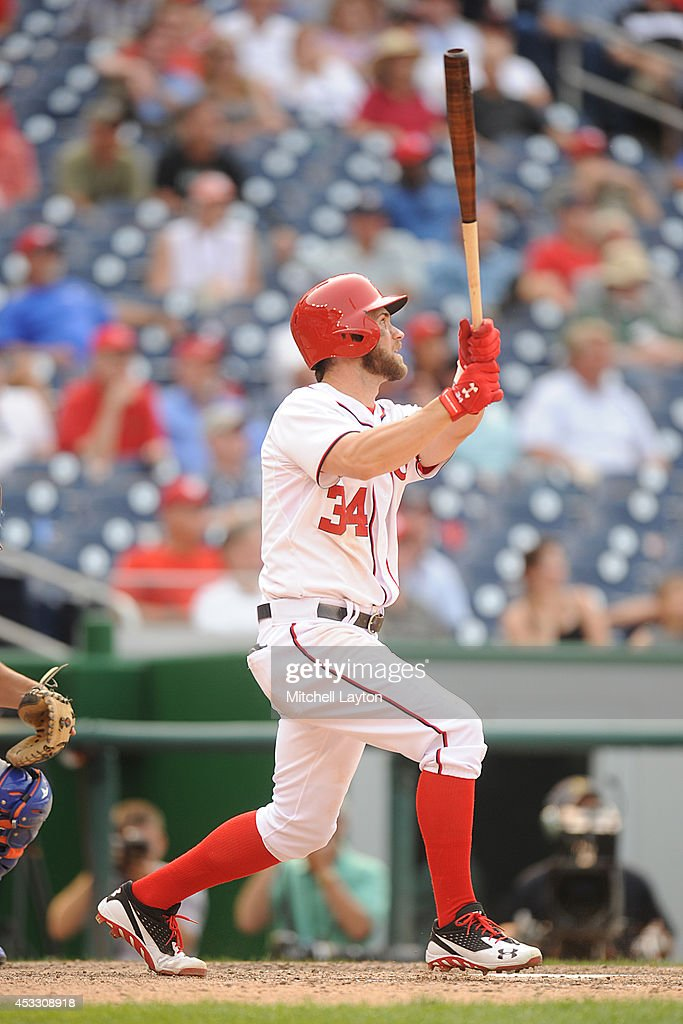 <a gi-track='captionPersonalityLinkClicked' href=/galleries/search?phrase=Bryce+Harper&family=editorial&specificpeople=5926486 ng-click='$event.stopPropagation()'>Bryce Harper</a> #34 of the Washington Nationals hits a two run walk off home run in the 13th inning during a baseball game against the New York Mets on August 7, 2014 at Nationals Park in Washington, DC. The Nationals won6-3 in the 13th inning.