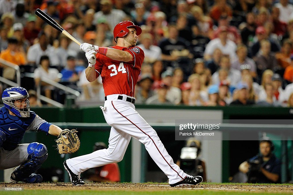 <a gi-track='captionPersonalityLinkClicked' href=/galleries/search?phrase=Bryce+Harper&family=editorial&specificpeople=5926486 ng-click='$event.stopPropagation()'>Bryce Harper</a> #34 of the Washington Nationals hits against the New York Mets at Nationals Park on August 18, 2012 in Washington, DC.