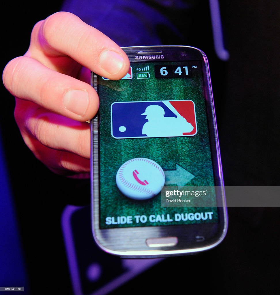 Bryce Harper of the Washington Nationals holds a mobile phone during a T-Mobile news conference at the 2013 International CES at The Venetian on January 8, 2013 in Las Vegas, Nevada. T-Mobile announced a partnership with Major League baseball. CES, the world's largest annual consumer technology trade show, runs through January 11 and is expected to feature 3,100 exhibitors showing off their latest products and services to about 150,000 attendees.