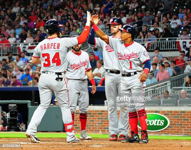 Bryce Harper of the Washington Nationals is congratulated by teammates after hitting his second home run of the game this time a seconginning grand...