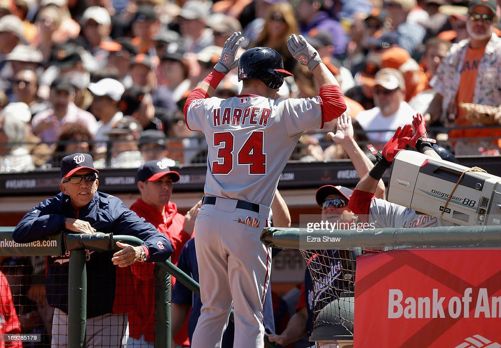 Bryce Harper #34 of the Washington Nationals is congratulated by teammates in the dugout after he hit a home run in the sixth inning of their game against the San Francisco Giants at AT&T Park on May 22, 2013 in San Francisco, California.