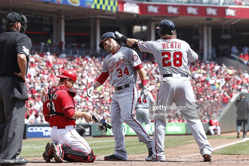 Bryce Harper #34 of the Washington Nationals is congratulated by Jayson Werth #28 after hitting a two-run home run in the third inning of the game against the Cincinnati Reds at Great American Ball Park on April 6, 2013 in Cincinnati, Ohio.