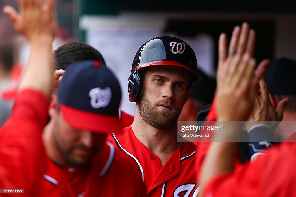 <a gi-track='captionPersonalityLinkClicked' href=/galleries/search?phrase=Bryce+Harper&family=editorial&specificpeople=5926486 ng-click='$event.stopPropagation()'>Bryce Harper</a> #34 of the Washington Nationals is congratulated in the dugout after scoring a run against the St. Louis Cardinals in the eighth inning at Busch Stadium on April 30, 2016 in St. Louis, Missouri.