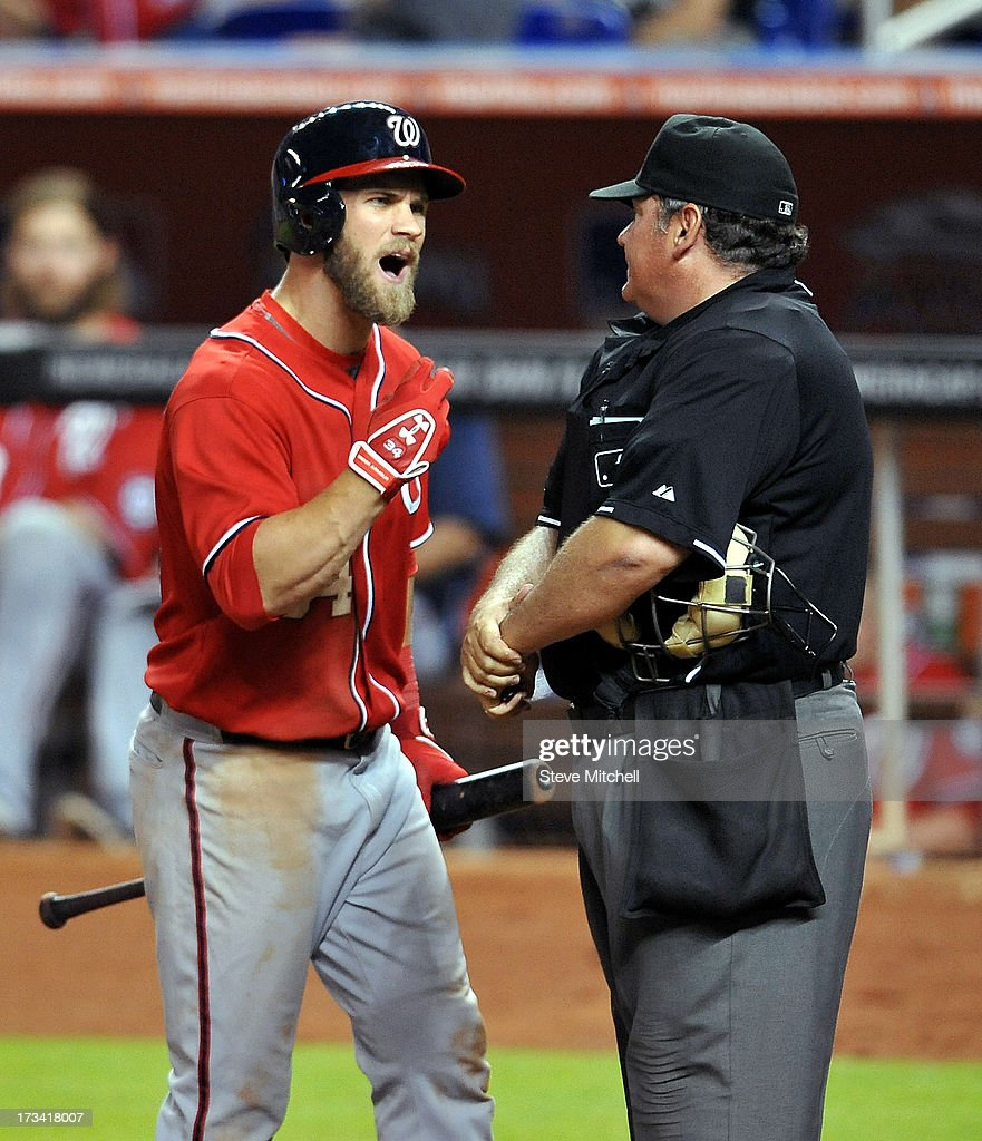 <a gi-track='captionPersonalityLinkClicked' href=/galleries/search?phrase=Bryce+Harper&family=editorial&specificpeople=5926486 ng-click='$event.stopPropagation()'>Bryce Harper</a> #34 of the Washington Nationals is ejected by home plate umpire <a gi-track='captionPersonalityLinkClicked' href=/galleries/search?phrase=Hunter+Wendelstedt&family=editorial&specificpeople=171442 ng-click='$event.stopPropagation()'>Hunter Wendelstedt</a> during the eighth inning against the Miami Marlins at Marlins Park on July 13, 2013 in Miami, Florida.