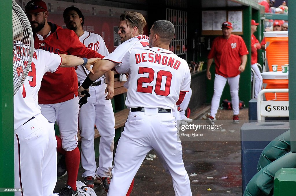 Bryce Harper of the Washington Nationals is pulled away by Ian Desmond after an altercation with Jonathan Papelbon in the eighth inning against the...