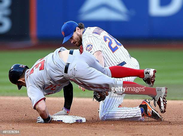 Bryce Harper of the Washington Nationals is safe at second after he hit a double in the ninth inning as Daniel Murphy of the New York Mets tries to...
