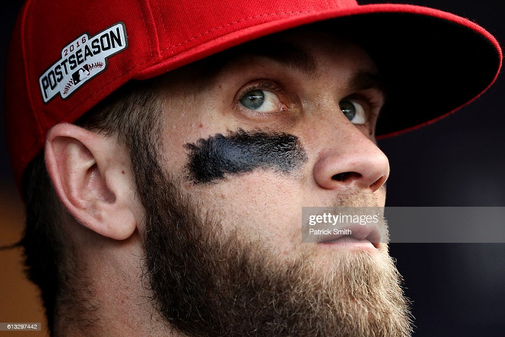 Bryce Harper of the Washington Nationals looks on against the Los Angeles Dodgers prior to game one of the National League Division Series at...