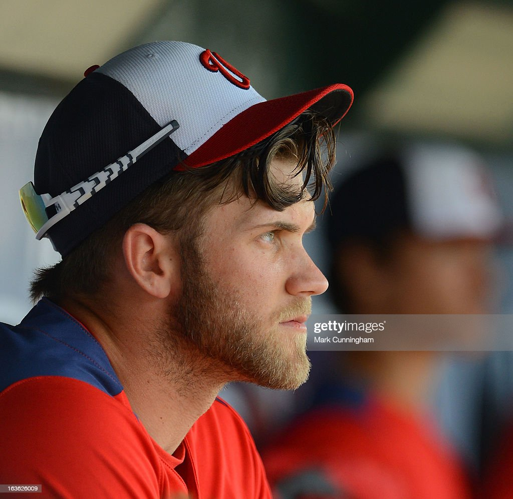 Bryce Harper #34 of the Washington Nationals looks on from the dugout during the spring training game against the Detroit Tigers at Joker Marchant Stadium on March 10, 2013 in Lakeland, Florida. The Tigers defeated the Nationals 2-1.