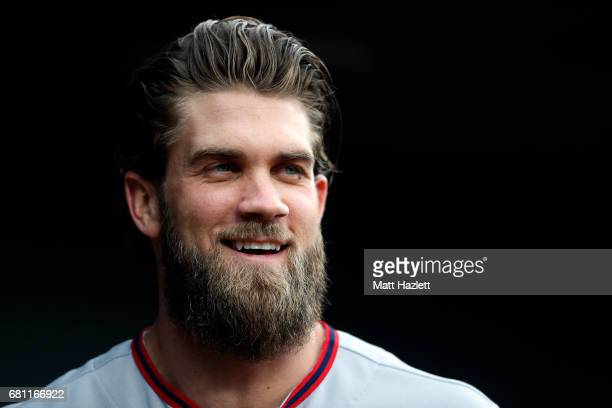 Bryce Harper of the Washington Nationals looks on from the dugout prior to a game against the Baltimore Orioles at Oriole Park at Camden Yards on May...