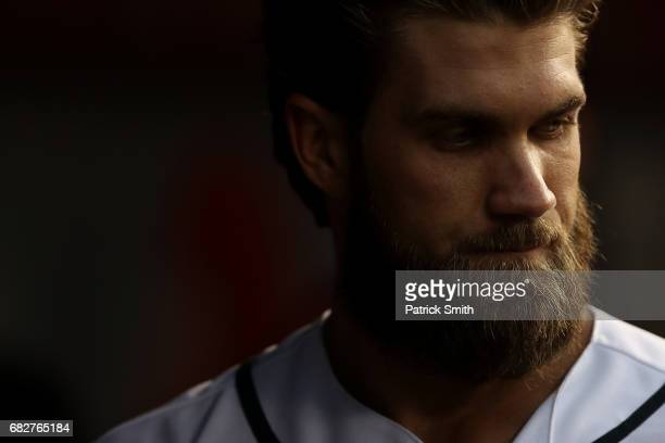Bryce Harper of the Washington Nationals looks on in the dugout against the Philadelphia Phillies at Nationals Park on May 13 2017 in Washington DC
