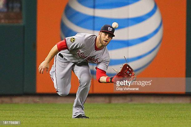 Bryce Harper of the Washington Nationals makes a catch against the St Louis Cardinals in the first inning at Busch Stadium on September 24 2013 in St...