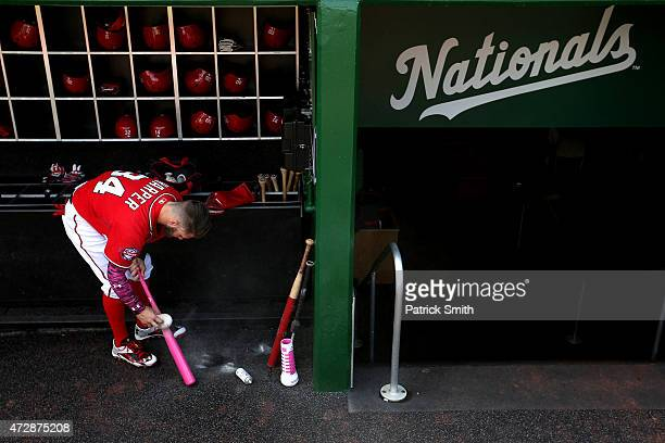 Bryce Harper of the Washington Nationals powders his bat before playing against the Atlanta Braves at Nationals Park on May 10 2015 in Washington DC
