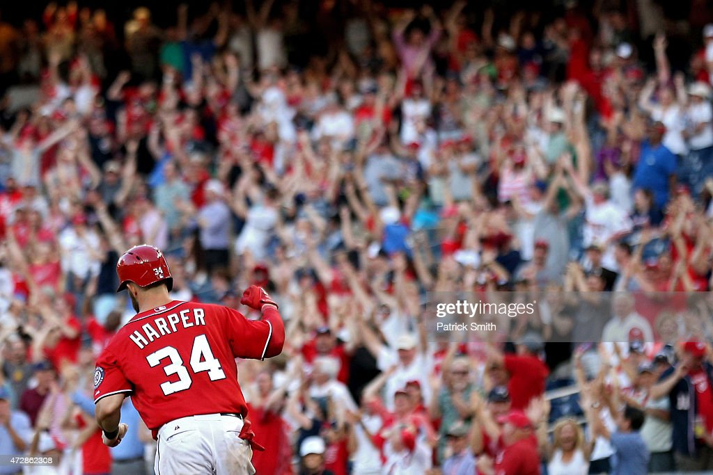 Bryce Harper of the Washington Nationals pumps his fist after hitting a walk off home run in the ninth inning against the Atlanta Braves at Nationals...
