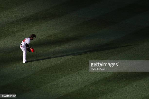 Bryce Harper of the Washington Nationals puts his hat on before playing against the Milwaukee Brewers at Nationals Park on July 25 2017 in Washington...
