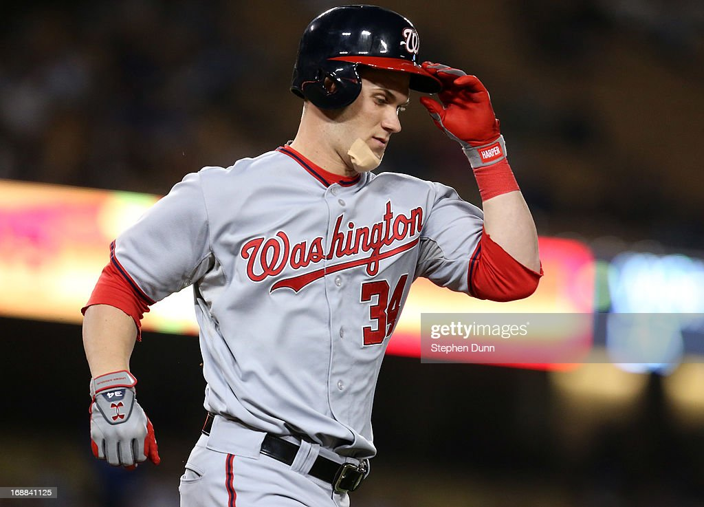 <a gi-track='captionPersonalityLinkClicked' href=/galleries/search?phrase=Bryce+Harper&family=editorial&specificpeople=5926486 ng-click='$event.stopPropagation()'>Bryce Harper</a> #34 of the Washington Nationals reacts after grounding out as a pinch hitter in the ninth inning against the Los Angeles Dodgers at Dodger Stadium on May 15, 2013 in Los Angeles, California. The Dodgers won 3-1.
