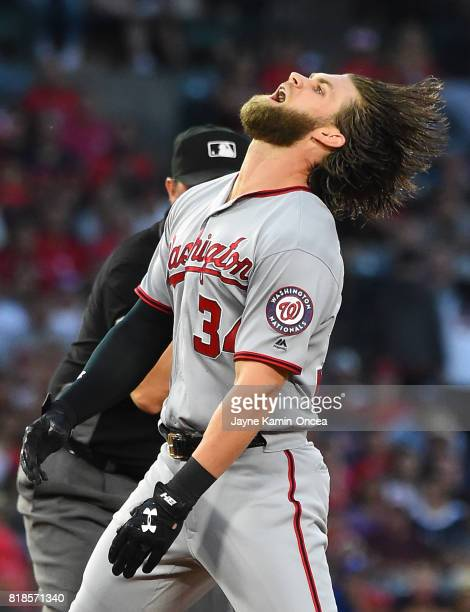 Bryce Harper of the Washington Nationals reacts after he was tagged out at second base going for a double in the third inning of the game against the...