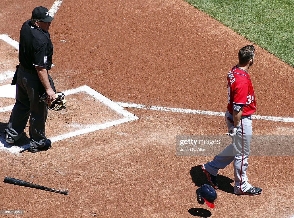 Bryce Harper #34 of the Washington Nationals reacts after striking out with home plate umpire Bob Davidson during the game on May 5, 2013 at PNC Park in Pittsburgh, Pennsylvania.